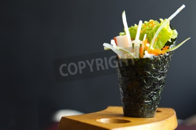Poster Japanese food, California hand roll hold in a wooden fixture