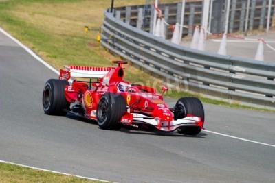 Poster JEREZ DE LA FRONTERA, SPAIN - OCT 10: Marc Gene of Scuderia Ferrari F1 take a curve on training session on October 10 , 2006 in Jerez de la Frontera , Spain