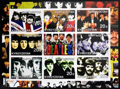 Poster KIRZIGUISTAN - CIRCA 2001  Collection stamps printed in Kirziguistan shows the Beatles, circa 2001