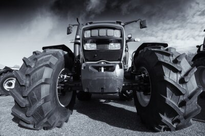 Poster large farming tractor under a stormy sky
