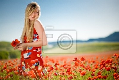 Laughing woman in poppy field