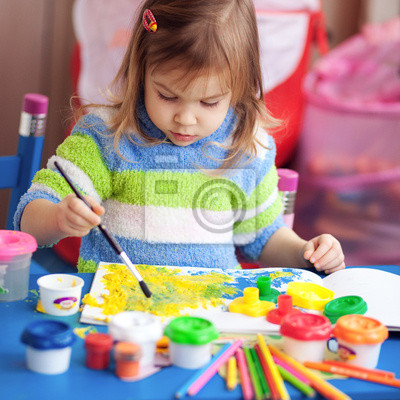 Little girl painting