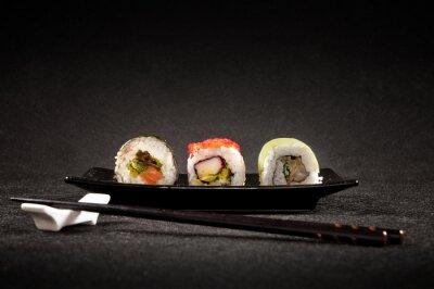 Poster Luxurious sushi on black background - japanese cuisine