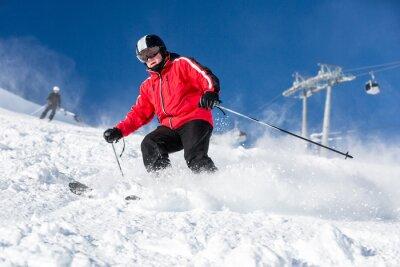 Poster Male skier skiing at ski resort