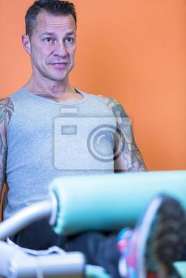 Poster man making leg extension - workout routine .