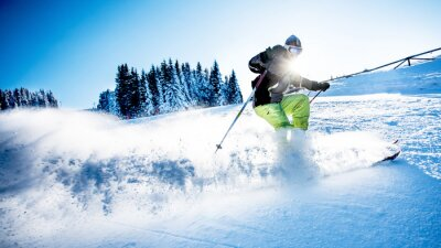 Poster Man skiing downhill