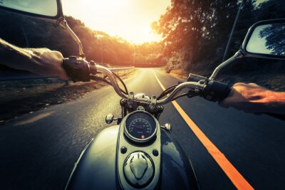 Poster Motorcycle on the empty asphalt road