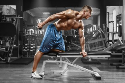 Poster Muscular man working out in gym doing exercises with dumbbells at triceps, strong male naked torso abs