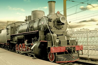Poster Old steam locomotive at station