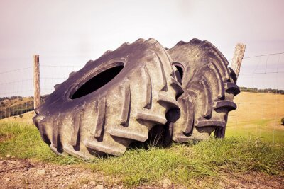 Poster Pair of tires of a big tractor dismantled and left in a Italian