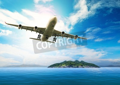Poster passenger plane flying over beautiful blue ocean and island in purity destination sea beach use for summer holiday vacation treveling