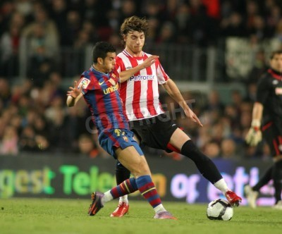 Poster Pedro of Barcelona and Amorebieta of Bilbao in action during a Spanish League match between FC Barcelona and Athletic Bilbao at the Nou Camp Stadium on April 3, 2010 in Barcelona, Spain