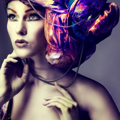 Poster Photo of beautiful girl in a head-dress from the coloured fabric
