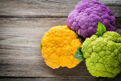 Poster Rainbow of eco cauliflower on the wooden table.