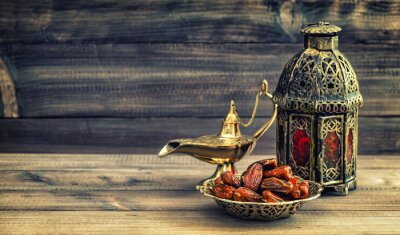 Poster Ramadan lamp and dates on wooden background. Oriental lantern