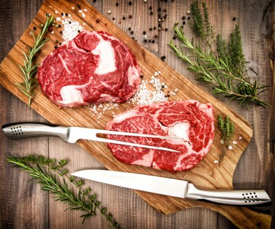 Poster Raw fresh meat Ribeye Steak with herbs and spices. Retro style