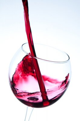 Poster Red wine pouring into wine glass