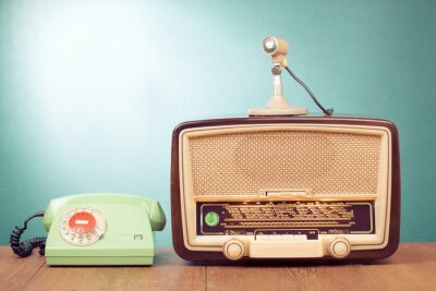 Poster Retro radio with green light, microphone and telephone on table