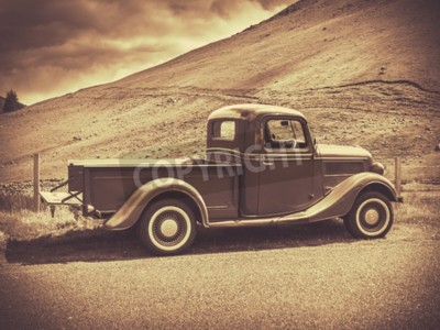 Poster Retro Style Sepia Image Of A Vintage Truck In The Countryside