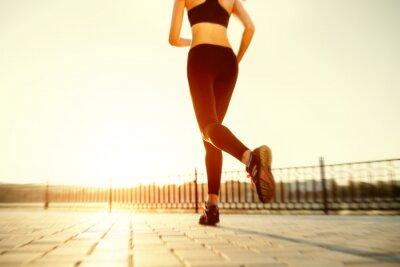 Poster Runner feet running on road closeup on shoe. woman fitness sunri