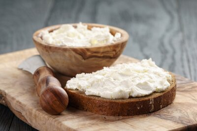 Poster rye bread with cream cheese on wood table