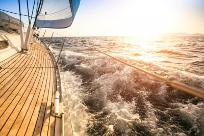 Poster Sailing to the Sunrise. Luxury yacht.
