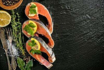Poster Salmon filets served on black stone