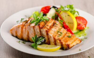 Poster Salmon with  fresh salad.