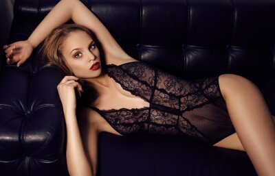 Poster sensual girl with long dark hair wearing luxurious lace lingerie