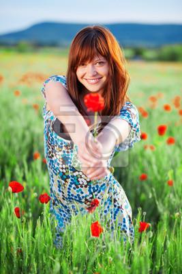 Smiling girl giving flower