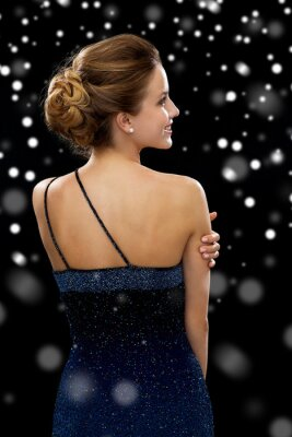 Poster smiling woman in evening dress