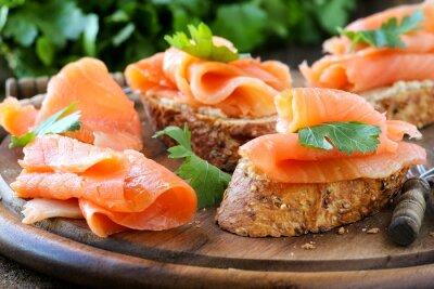 Poster Smoked salmon free canape parsley leaf on wood