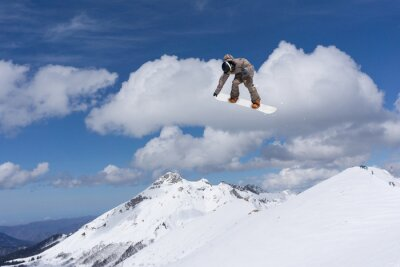 Poster Snowboard jump on mountains. Extreme sport.