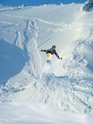Poster Snowboarding. Mountain-skier jumps. A lot of copyspace