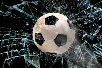 Poster Soccer ball through glass.