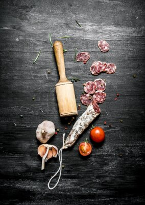 Poster Spicy salami with tomatoes and garlic.