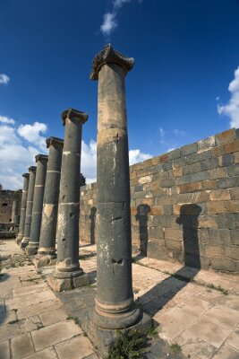 Poster Syria. Bosra. The remains of the Roman baths - basalt columns. This site is on UNESCO World Heritage List