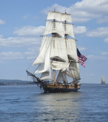 Poster Tall ship with American flag sailing on blue waters