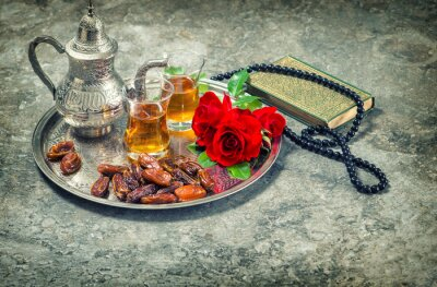 Poster Tea and red rose flower, holy book quran and rosary. Ramadan kar