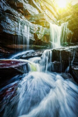 Poster Tropical waterfall with sun rays