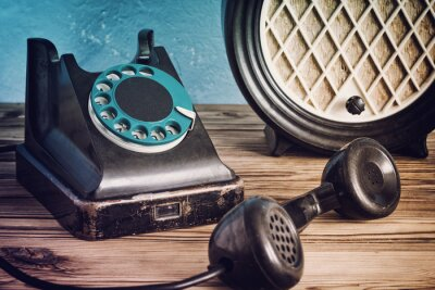 Poster Vintage phone and radio on a wooden table