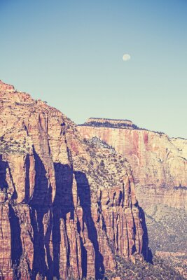 Poster Vintage toned moon over mountains in Zion National Park, USA.