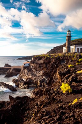 Poster Volcanic landscape with lighthouse near salt factory Fuencaliente on La Palma island in Spain