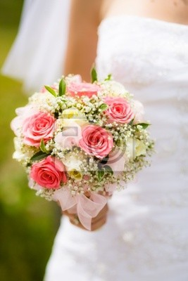 Wedding bouquet with white and pink roses in bride hand