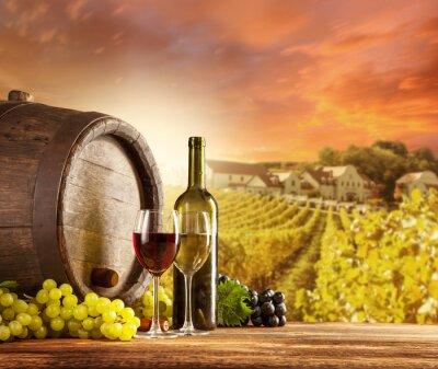 Poster Wine still life with vineyard on backgorund