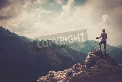 Poster Woman hiker on a top of a mountain