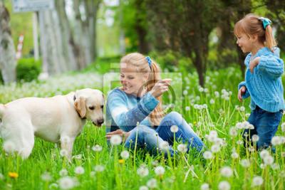Woman with girl and dog