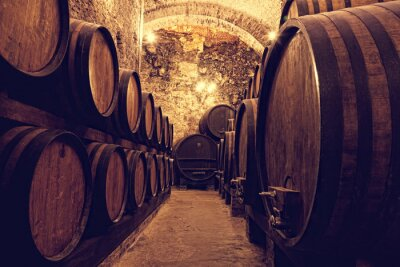 Poster  Wooden barrels with wine in a wine vault, Italy
