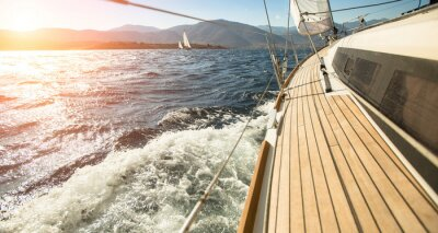 Poster Yacht sailing towards the sunset. Sailing. Luxury yachts.