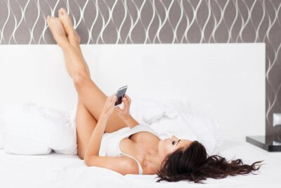 Poster Young beautiful woman in her bed